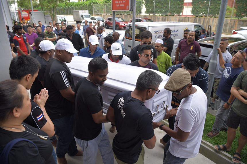 Friends and family members carrying the coffin of veteran bodybuilder Pradip Subramanian who died after a celebrity muay thai match against YouTube personality Steven Lim.