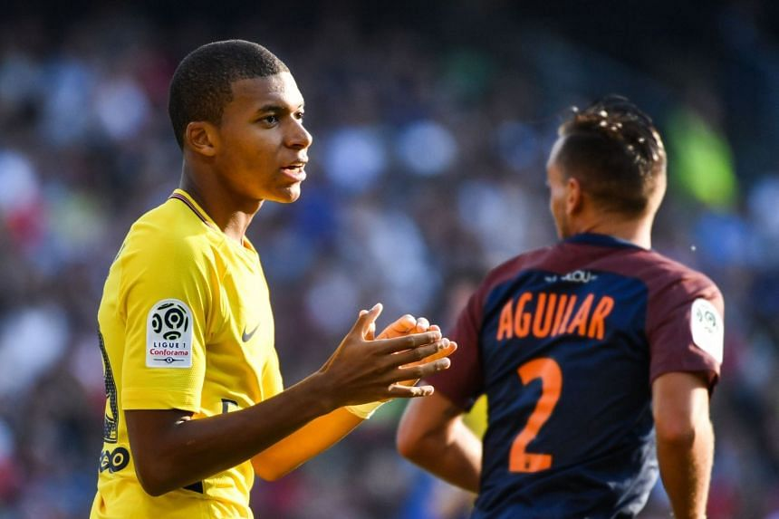 PSG's Kylian Mbappe reacts during the French Ligue 1 match.
