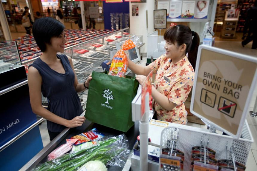 A customer supporting the Bring Your Own Bag, a FairPrice Green Rewards Scheme, which rewards customers with a 10-cent rebate when they bring their own bags with a minimum spend of S$10.