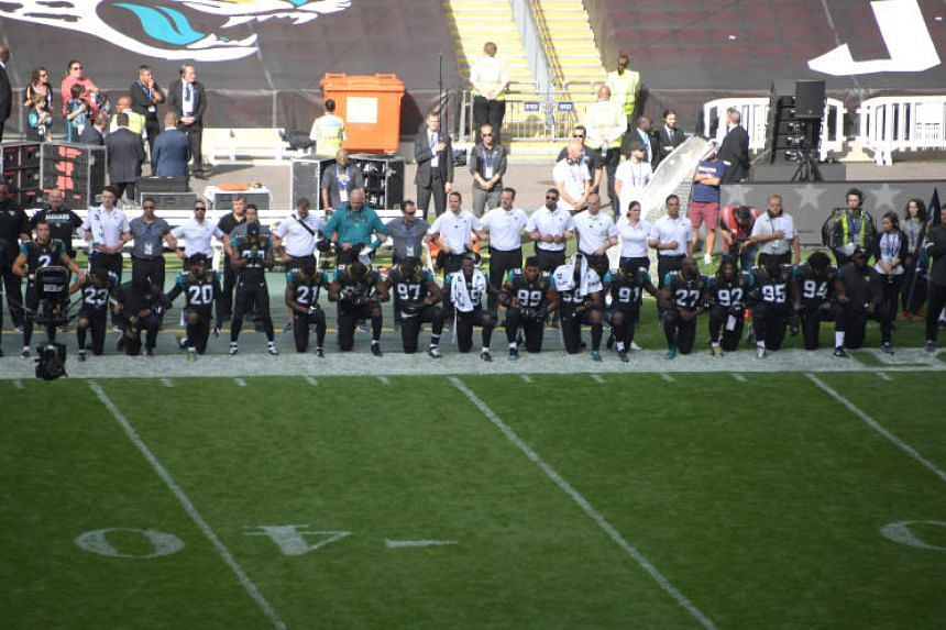 Jacksonville Jaguars players kneel during the playing of the US national anthem before an NFL International Series gameat London's Wembley Stadium on Sept 24, 2017.