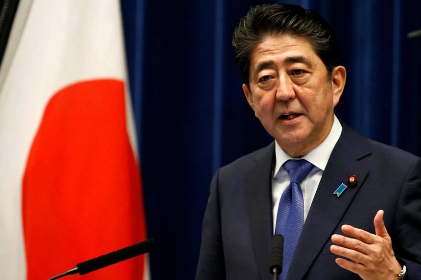 Japanese PM Shinzo Abe speaking at his official residence in Tokyo, where he announced snap elections, on Sept 25, 2017.