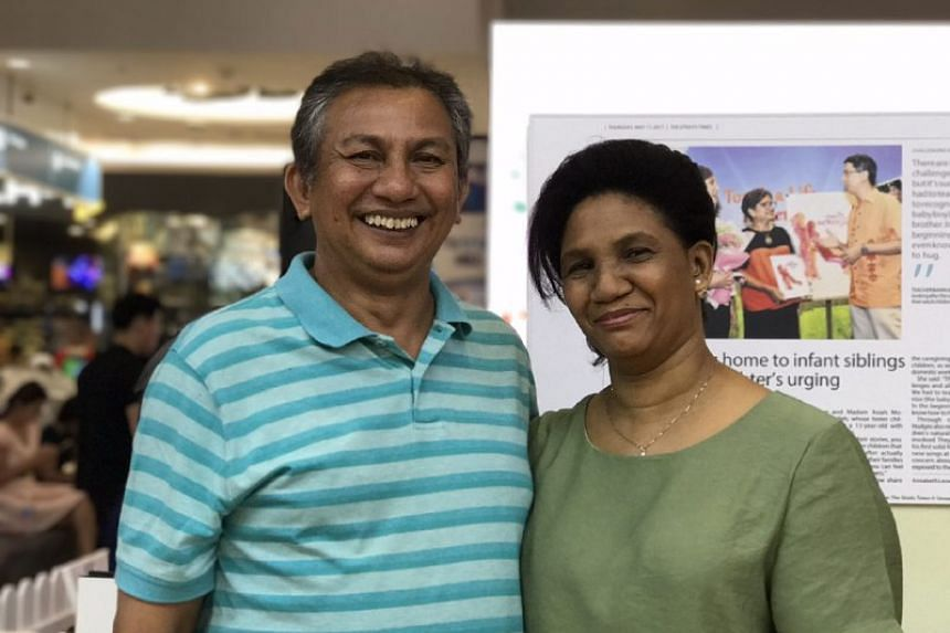 Mr Gerard Nonis and Madam Susanna Daniels are foster parents to six children, including 17-year-old Timothy, one of the participants in the event's photo exhibition.