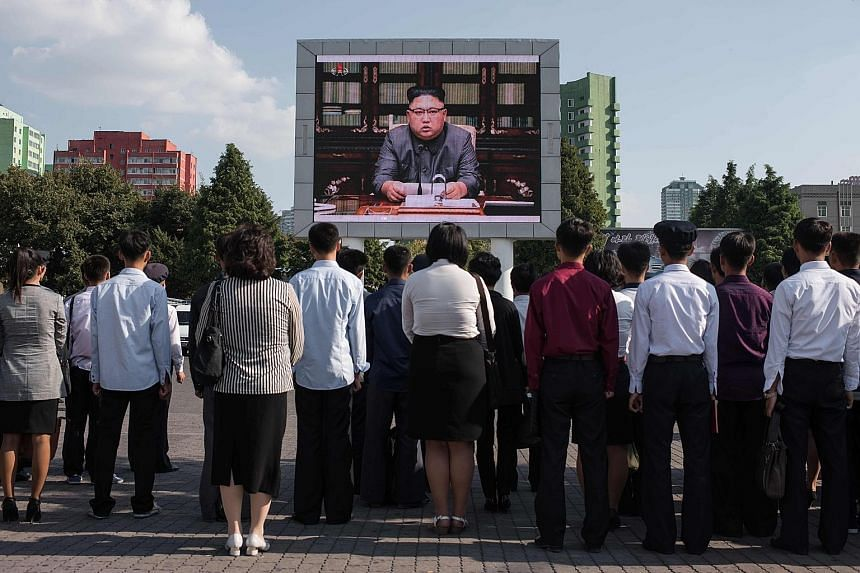 A news broadcast of a statement by North Korean leader Kim Jong Un on a public TV screen in Pyongyang last Friday.