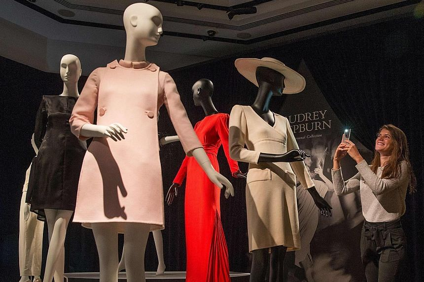 Audrey Hepburn's outfits (above), ballet pumps, script for the 1961 film Breakfast At Tiffany's and monogrammed powder compact at an exhibition at Christie's auction house in London.