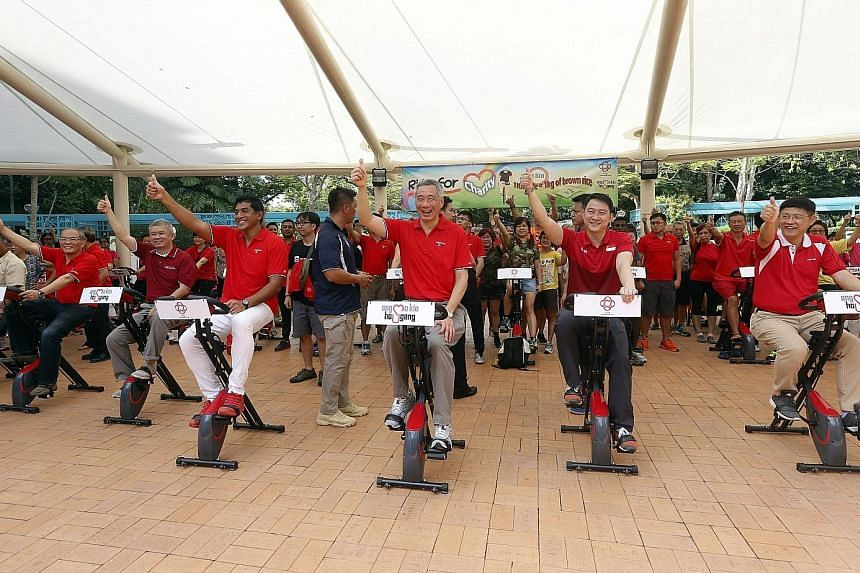 Prime Minister Lee Hsien Loong with fellow Ang Mo Kio GRC MPs (from far left) Ang Hin Kee and Darryl David, as well as Sengkang West MP Lam Pin Min, riding their hearts out yesterday as part of a special challenge to mark Ci Yuan Day. Every kilometre