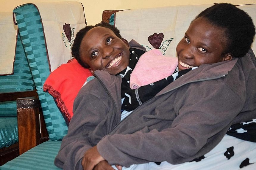 Sisters Maria and Consolata Mwakikuti, joined at the abdomen, have become minor celebrities in Tanzania, where the media has followed their path through high school and arrival at university.