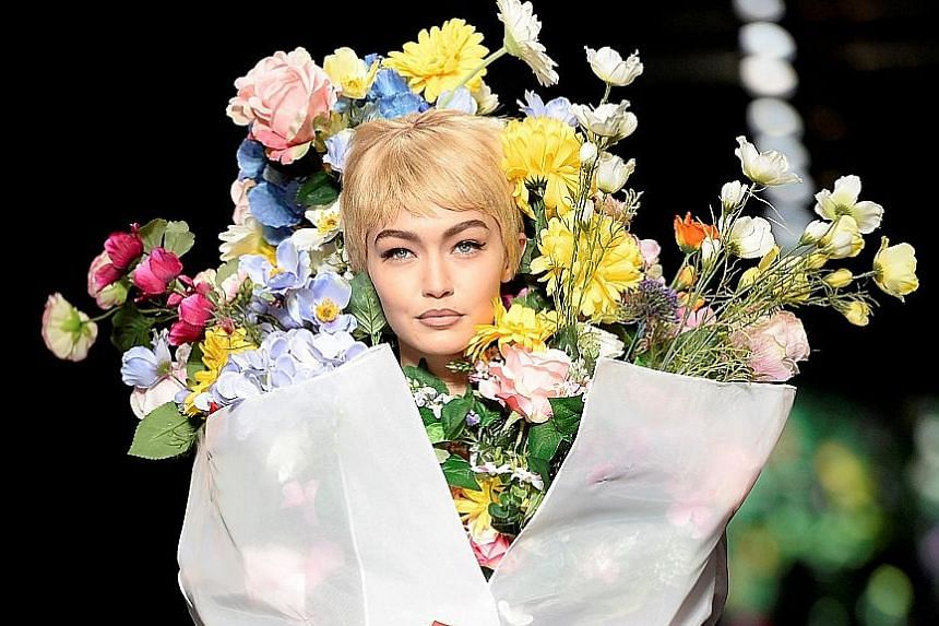 Model Gigi Hadid in a flowery creation from the Moschino Spring/ Summer 2018 show.