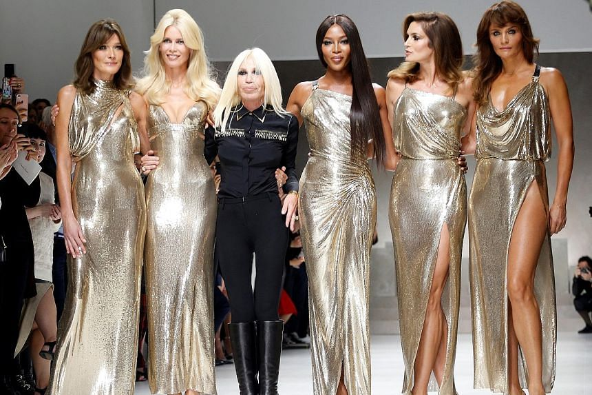 Italian designer Donatella Versace (in black) with former top models (from left) Carla Bruni, Claudia Schiffer, Naomi Campbell, Cindy Crawford and Helena Christensen.