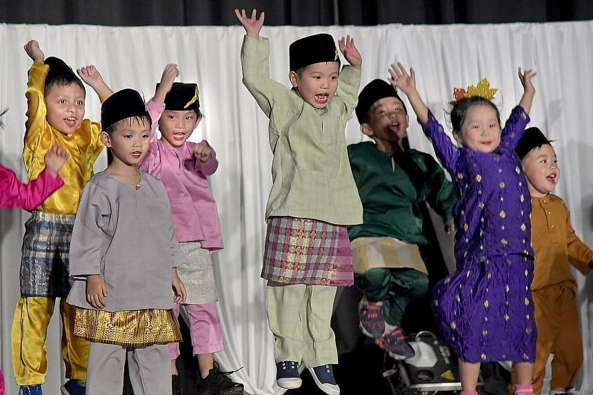 Children from PCF Sparkletots Preschool performing at Gerbang Bahasa held at Northbrooks Secondary School in Yishun last night.