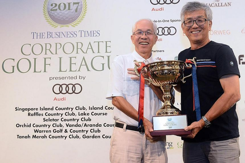 Boustead executive chairman Wong Fong Fui (left) and Tat Hong skipper Michael Ng holding the Business Times Corporate Golf League trophy at the Tanah Merah Country Club last Friday. For the first time in the league's eight-year history, two teams wer