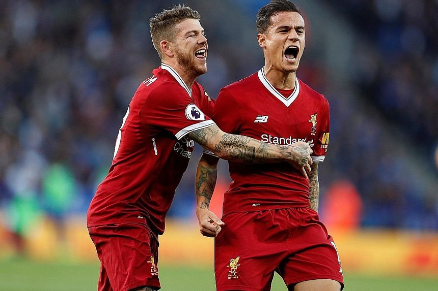 Above: Liverpool's Philippe Coutinho (right) celebrating with Alberto Moreno after scoring their second goal against Leicester City on Saturday. The Brazilian's performance was crucial in securing victory and moving Jurgen Klopp's side up to fifth in