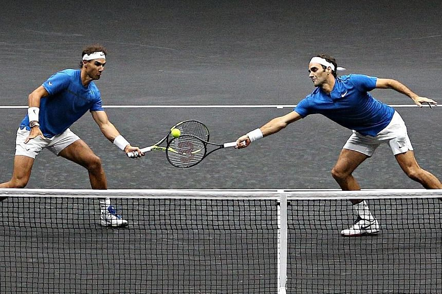Rafael Nadal and Roger Federer (right) in action on the same side of the net for once. The duo combined for Team Europe to beat Team World pair Sam Querrey and Jack Sock in their Laver Cup doubles match on Saturday.