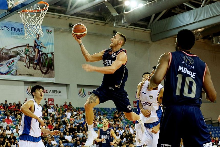 The Adelaide 36ers' Mitchell Creek going for an open layup during the Merlion Cup final at the OCBC Arena. The 36ers overpowered last year's winners Shanghai Sharks by 20 points to claim the Cup yesterday.
