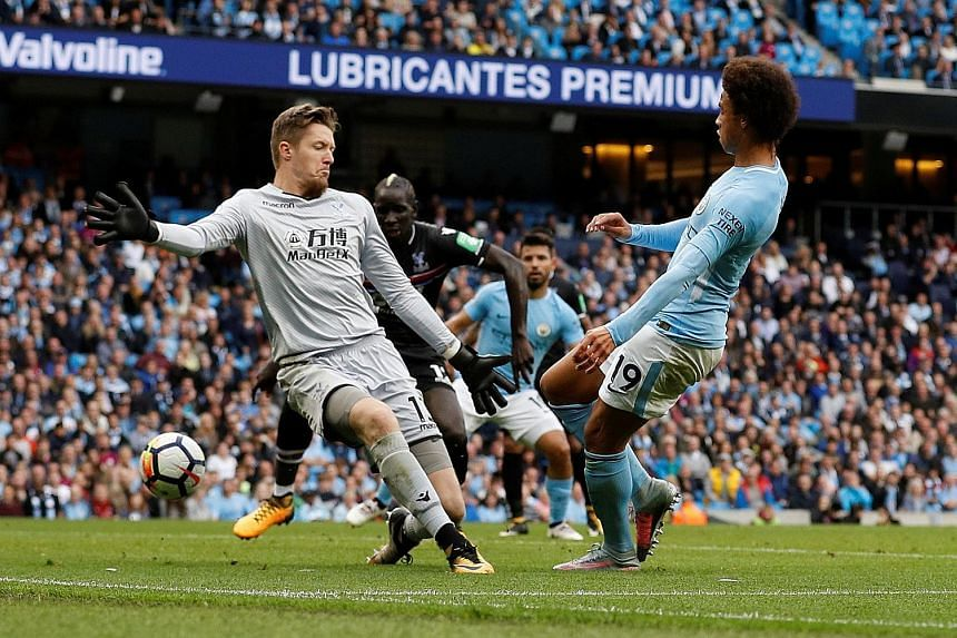 Leroy Sane puts the ball through Palace goalkeeper Wayne Hennessey's legs to net the first goal. His strike opened the floodgates for Manchester City to eventually win 5-0 after a goal-less first half.