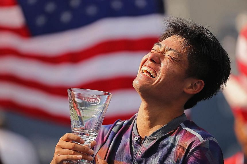 Wu Yibing with his US Open boys' singles trophy after defeating top seed Axel Geller of Argentina 6-4, 6-4 in the final this month.