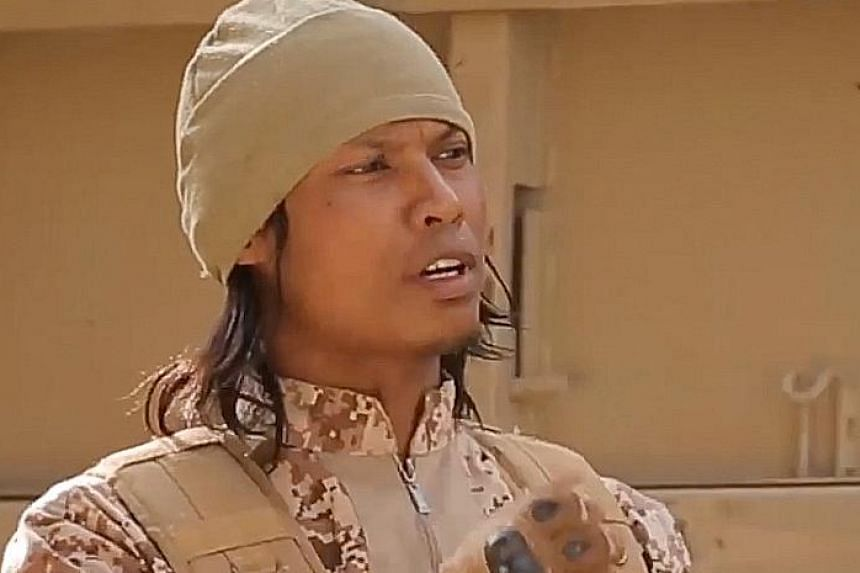 """In the ISIS recruitment video, Megat Shahdan Abdul Samad identifies himself as """"Abu Uqayl from Singapore""""."""