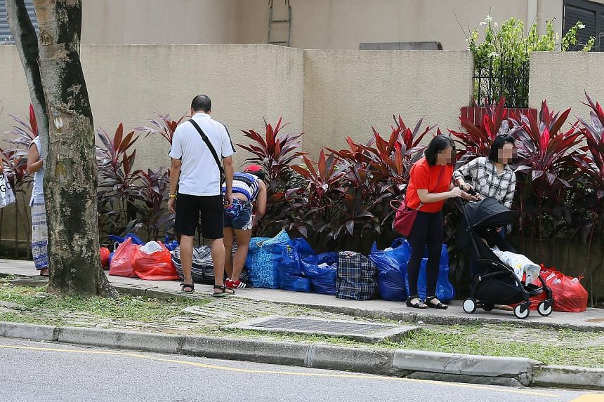 Bags of items at what appeared to be a makeshift stall outside Richmond Park condo near Lucky Plaza yesterday. From as early as July last year, mall retailers have noticed itinerant sellers hawking items out of bags.