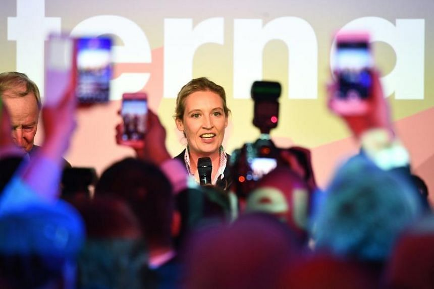Alice Weidel, co-top candidate for the general elections of the German right-wing populist party 'Alternative for Germany' (AfD), speaks to journalists and supporters at a night club on Sunday (Sept 24, 2017).