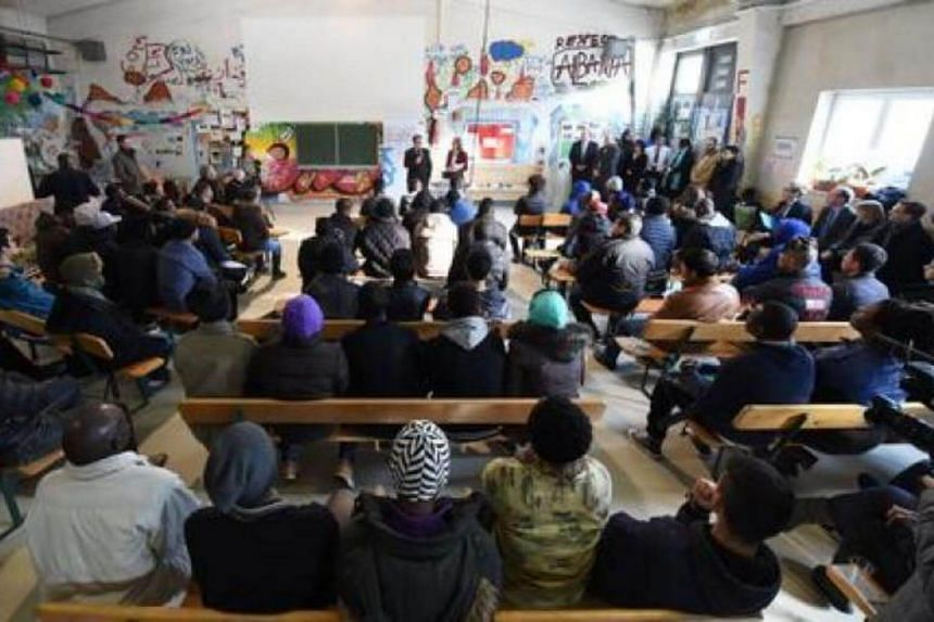Migrants following lessons for refugees and asylum seekers on German legislation in Munich, Germany on Feb 24, 2016.