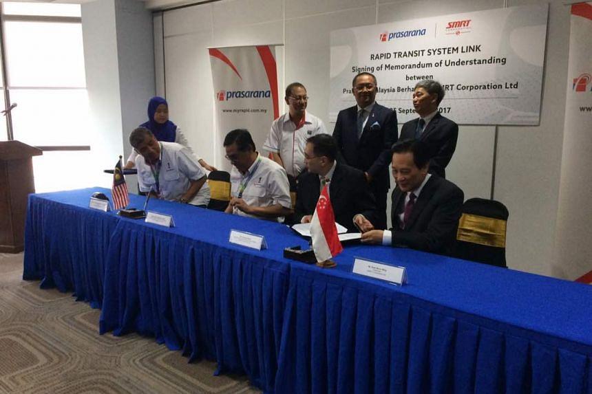 (From left) Chairman of Prasarana Tan Sri Dato' Khalid Abu Bakar, Prasarana President and Group CEO Datuk Seri Azmi Abdul Aziz, SMRT President and Group Chief Executive Officer Desmond Kuek, and SMRT Chairman Seah Moon Ming.