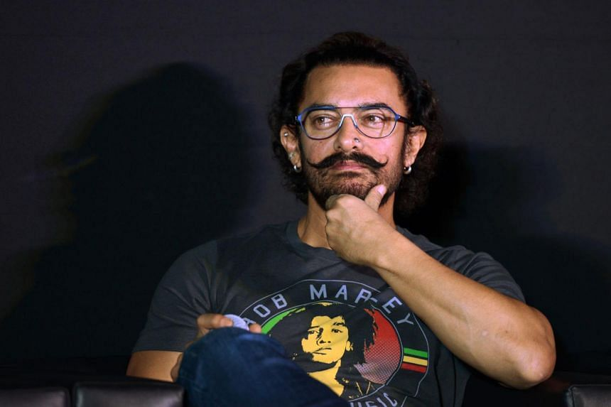 Bollywood actor Aamir Khan gestures during a news conference to launch a music track of his new film 'Secret Superstar' in Mumbai on Aug 21, 2017.