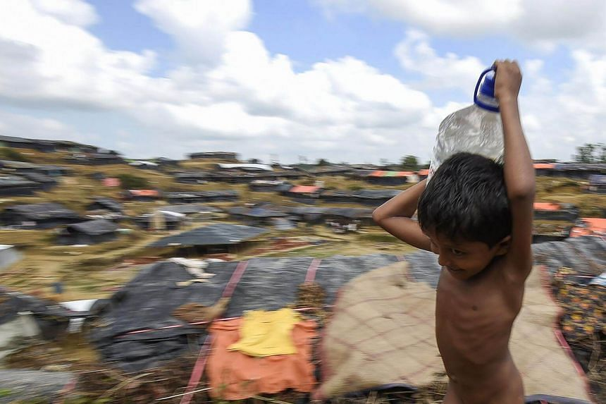 A young Rohingya refugee carrying water at the Balukhali refugee camp in Ukhia, on Sept 22, 2017.