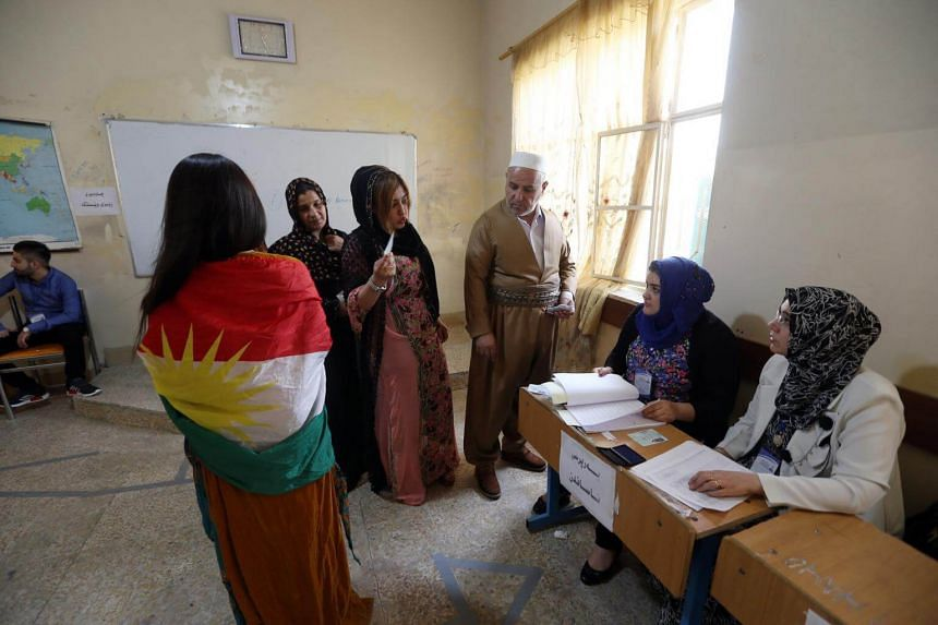 Iraqi Kurds voting at a polling stations during the Kurdistan independence referendum in Erbil, Iraq, on Sept 25, 2017.
