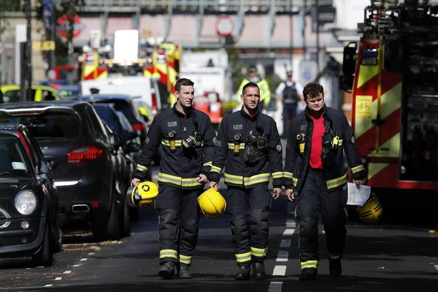 London Fire Brigade personnel working near Parsons Green tube station in London, after a bomb went off, on Sept 15, 2017.