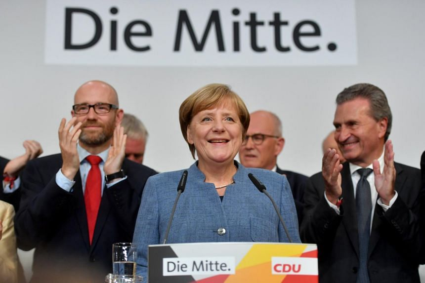 German Chancellor Angela Merkel (centre) of the Christian Democratic Union (CDU) smiles at the CDU election event in Berlin, Germany, on Sept 24, 2017.