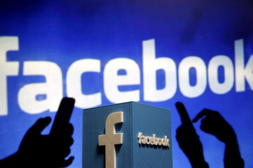 A 3D plastic representation of the Facebook logo is seen in this photo illustration on May 13, 2015.