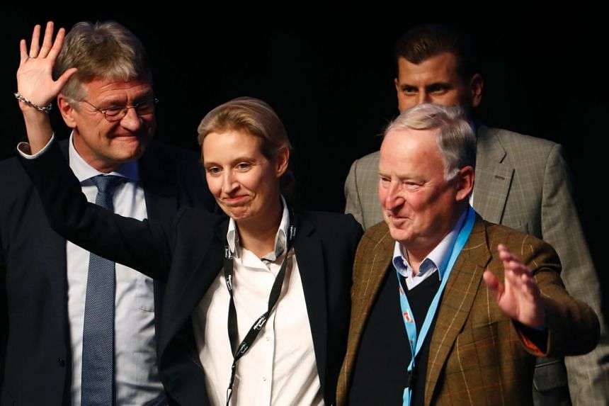 Alice Weidel (second from left) and Alexander Gauland (right) celebrate their nomination as campaign leaders of Germany's right-wing populist Alternative for Germany (AfD) party during the party congress on April 23, 2017.