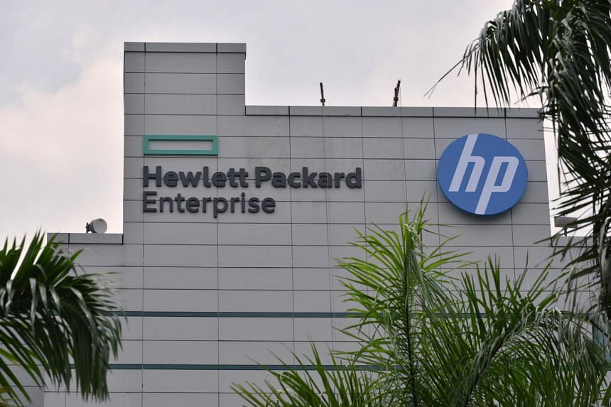 Logos of Hewlett-Packard Enterprise (HPE) and HP Inc on building at the tech firm's Alexandra Road office.