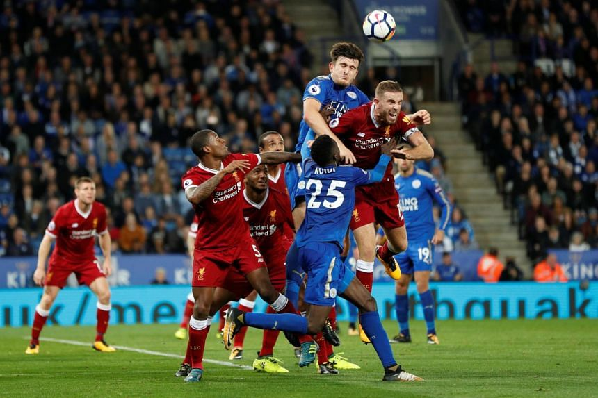 Leicester City's Harry Maguire in action with Liverpool's Jordan Henderson, on Sept 23, 2017.