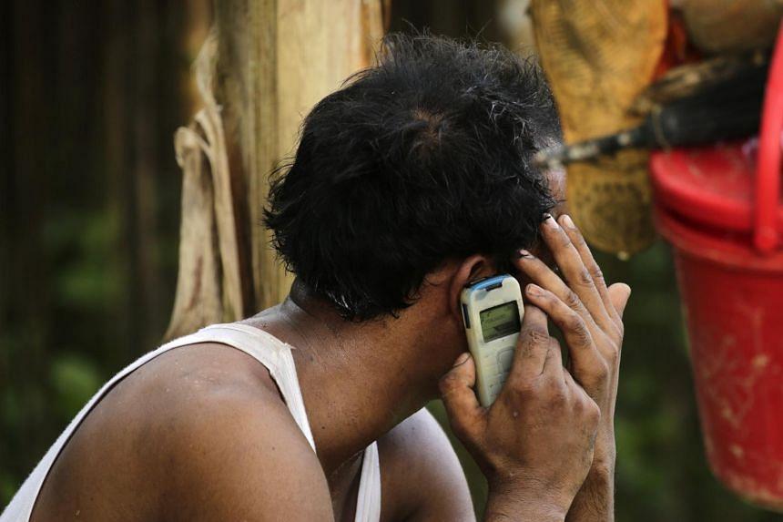 A Rohingya man talks on his mobile phone as he arrives in Tuangiri, Teknaf, Bangladesh, on Sept 12, 2017.
