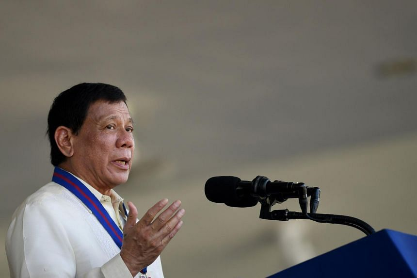 Philippine President Rodrigo Duterte gestures as he gives a speech during the 116th anniversary of the Philippine National Police (PNP) at its headquarters in Manila, on Aug 9, 2017.