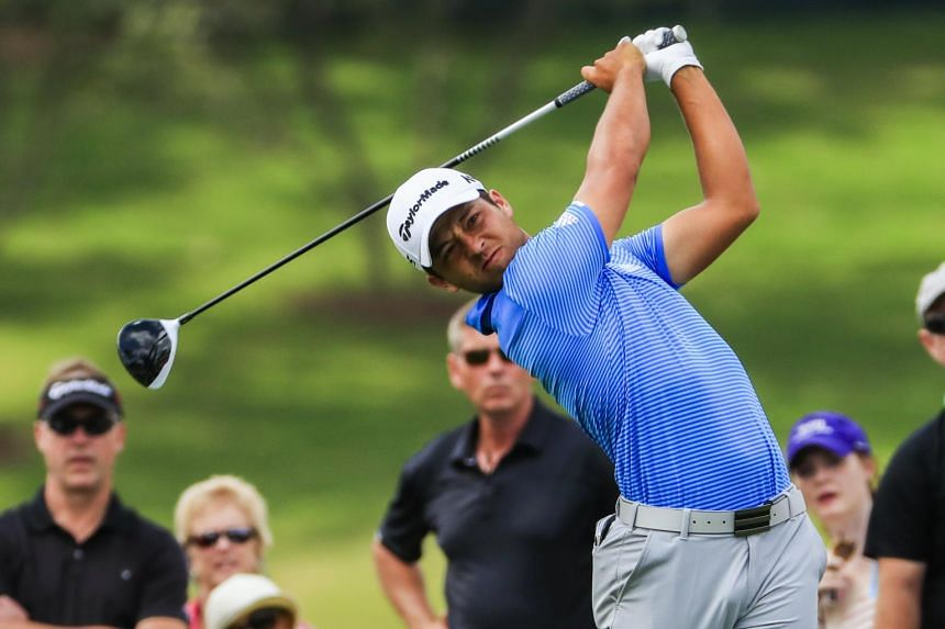 Xander Schauffele hits his tee shot on the fourth hole during the fourth round of the Tour Championship, on Sept 24, 2017.