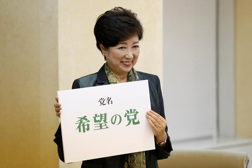 Tokyo Governor Yuriko Koike holds a placard reading her new party name Party of Hope during a news conference in Tokyo, Japan, on Sept 25, 2017.