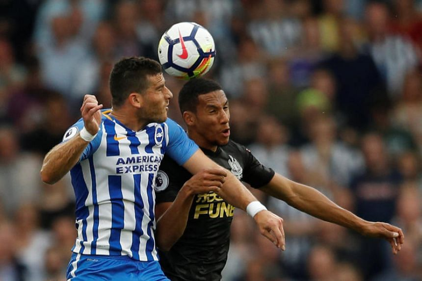 Brighton's Tomer Hemed in action with Newcastle United's Isaac Hayden on Sept 24, 2017.