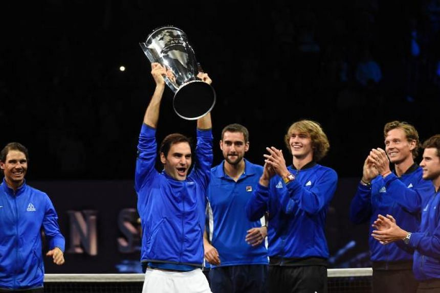 Roger Federer of Team Europe and his teammates celebrate with the Laver Cup trophy on Sept 24, 2017 in Prague.