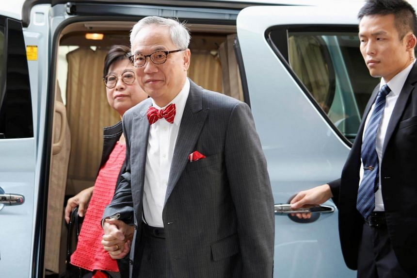 Former Hong Kong Chief Executive Donald Tsang (centre) and his wife Selina arrive at the High Court for his trial on a bribery charge in Hong Kong, on Sept 26, 2017.