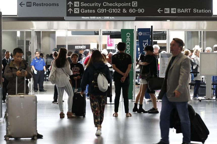 """Travellers at San Francisco International Airport in San Francisco, California, on June 30, 2017. Venezuela accused the United States on Monday of """"psychological terrorism"""" designed to bring down the government."""