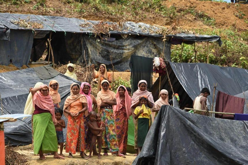 A group of Rohingya refugees at the newly-expanded camp housing refugees from Myanmar known as Kutupalong Extension in Bangladesh's Ukhia district.