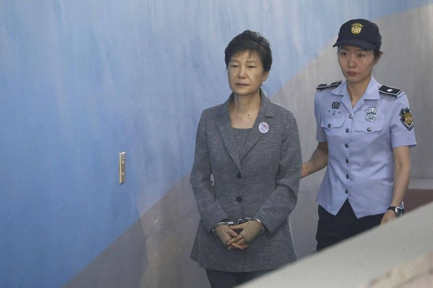 South Korean ousted leader Park Geun Hye (left) arrives at a court in Seoul, on Aug 25, 2017.