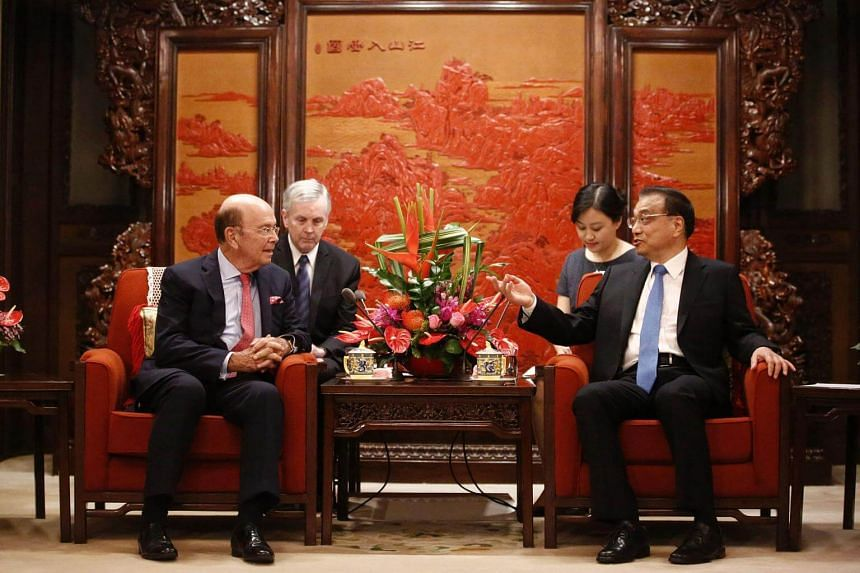 US Secretary of Commerce Wilbur Ross (left) speaks with Chinese Premier Li Keqiang (right) during their meeting at the Zhongnanhai state guesthouse in Beijing, on Sept 25, 2017.