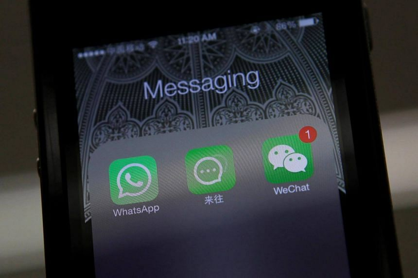 Icons of messaging applications WhatsApp (left), Laiwang (centre) and WeChat, or Weixin.