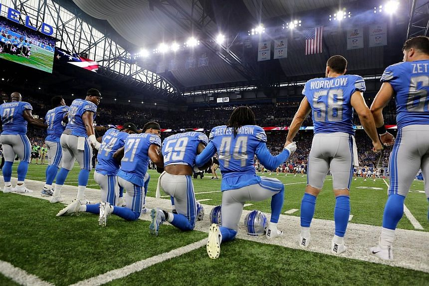 Detroit Lions players kneeling during the US national anthem on Sunday.