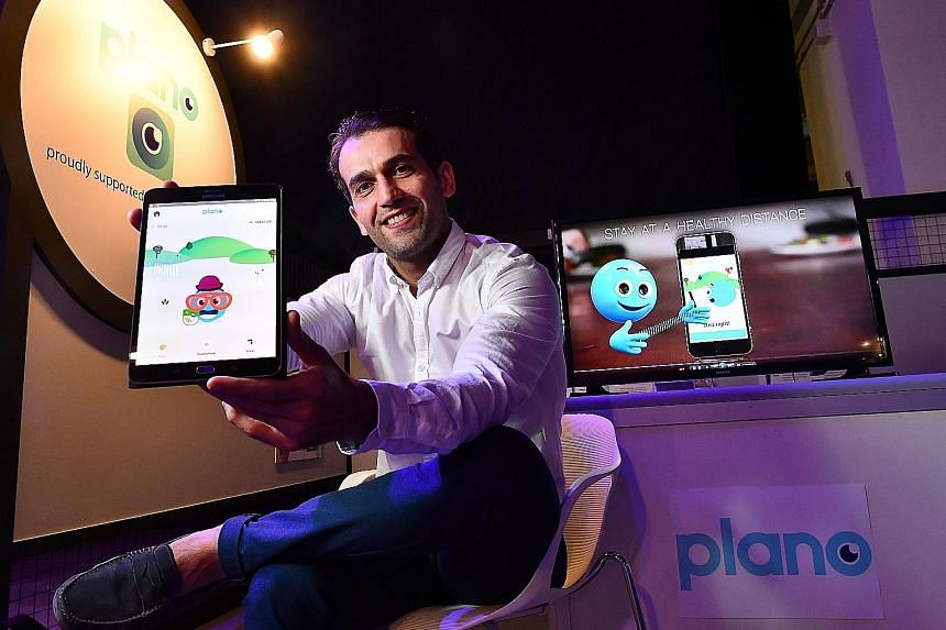 Dr Mo Dirani, Plano's founder and chief executive officer, with his app. Parents can use it to monitor the frequency and length of time their children spend on devices and the distance at which they hold the device.