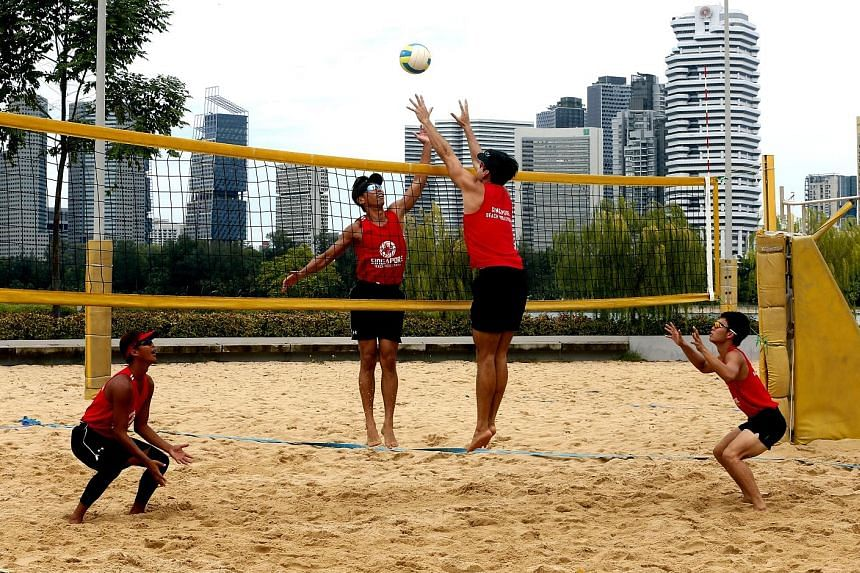 From left: National beach volleyball players Zhuo Hong Chuan, Gilbert Tan, Mark Shen and Poon Pei Jie training at the Singapore Sports Hub ahead of the Sept 28-30 South-east Asian Beach Volleyball Championships, which will be held at Sentosa's Palawa