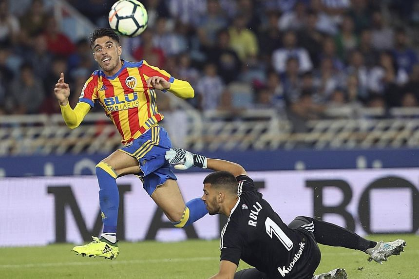 Valencia's Nacho Vidal lifting the ball over Real Sociedad goalkeeper Geronimo Rulli for his side's second goal. They remain unbeaten in six LaLiga games.