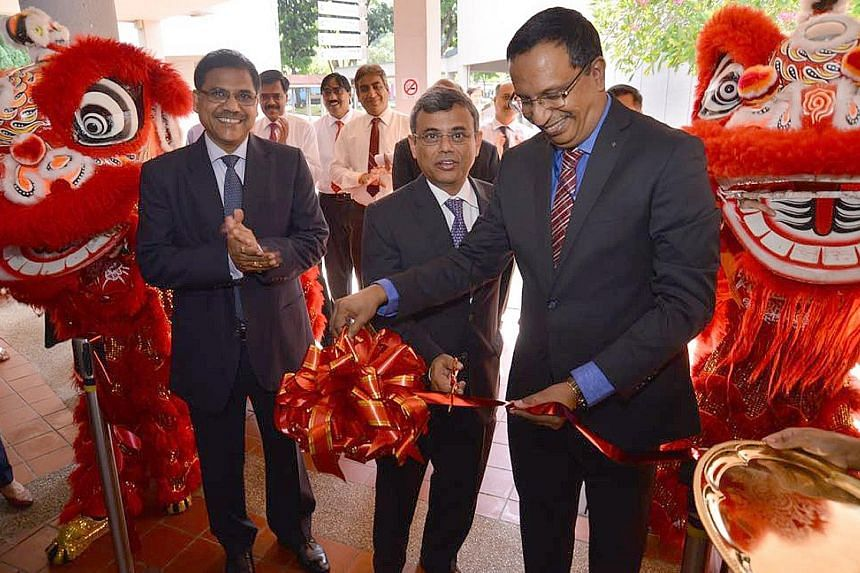Mr Jawed Ashraf (centre), the High Commissioner of India to Singapore, was the guest of honour at the inauguration of the State Bank of India's (SBI) Ang Mo Kio branch yesterday. With him were SBI chief executive officer Manaw Prasad (far left) and S